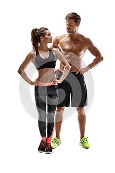 Sport, fitness, workout concept. Fit couple, strong muscular man and slim woman posing on a white background