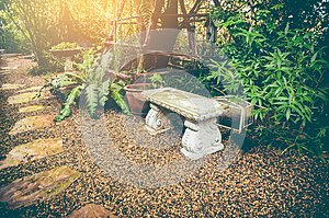 Relaxation corner with intricate granite bench. Vintage effect t