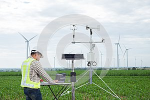 Engineer using tablet computer collect data with meteorological