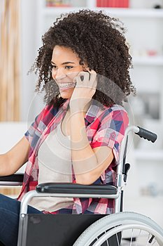 Happy beautiful disabled woman using phone