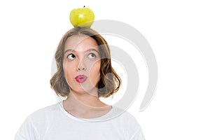 Thinking pretty caucasian woman holding apple on head