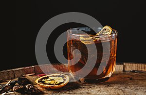 Smoked old fashioned cocktail on dark wooden background