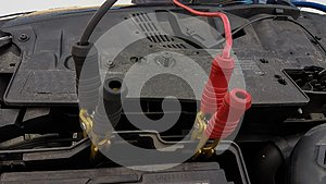 Car battery charging cords background