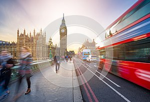 London, England - The iconic Big Ben and the Houses of Parliament with famous red double-decker bus
