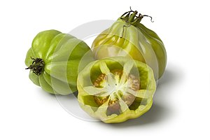Whole and half green Coeur de boeuf tomatoes