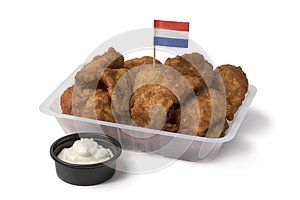 Plastic bowl with traditional Dutch kibbeling and sauce
