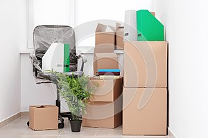 Office move concept. Carton boxes and chair