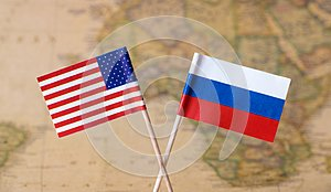 Flags of the USA and Russia over the world map, political leader countries concept image