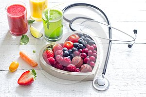Fresh fruits vegetables and heart shape with stethoscope health diet concept