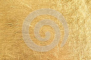 Gold shiny foil background, yellow gloss metallic texture