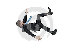 Young businessman falling down in free fall. Isolated on white background