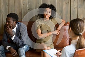 African frustrated wife talking to psychologist, family marriage