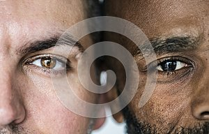 Two different ethnic men`s eyes closeup