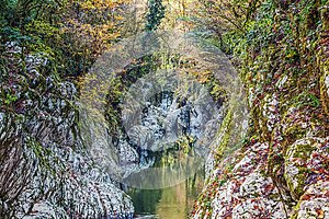A devil canyon in the gorge of the Khosta River in autumn. Sochi National Park.
