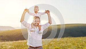 Father`s day. Happy family father and toddler son playing and l
