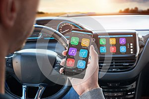 Driver uses a mobile phone with smart driving assistance apps