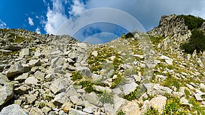 Difficult hiking trail going uphill through the rocks, Pirin mountains, Bulgaria