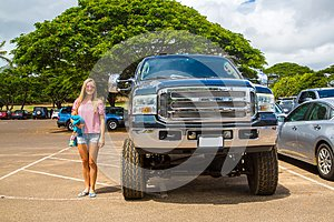 Huge Ford monster truck in comparison to a young lady