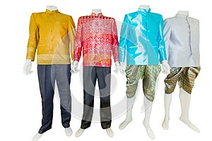 Beautiful Thai dresses on mannequins isolate white background wi