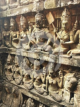 Cambodia Architecture. Bas-relief. A rough-carved figure on the frontage of the Terrace of the Leper King. Wall Carving