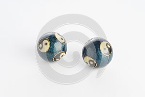 Two blue chinese yin yang balls on white background