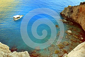 Greece summer coastline view. Blue sea water, mountain and boat