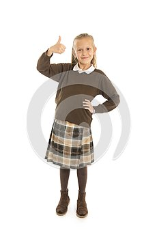 Portrait of 7 or 8 years old beautiful and happy schoolgirl female child in school uniform smiling cheerful isolated on white back
