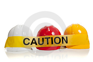 Various hard hats with caution tape