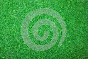 Green grass floor texture/Green artificial grass background vignette or the naturally walls texture Ideal for use in the design fa