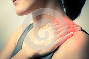 Closeup women neck and shoulder pain/injury with red highlights on pain area with white background, healthcare and medical concept