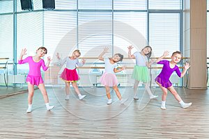 Children dancing in choreography class. happy children dancing on in hall, healthy life, kid`s togethern dance kid class
