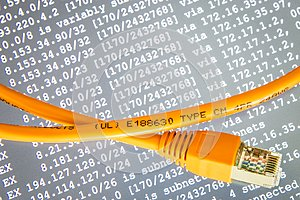 Orange internet cable on gray background with ip addresses