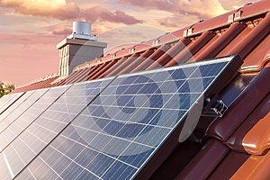 Roof of a house with solar panel or photovoltaic system