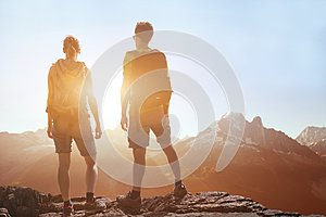 Travel, people traveling, hiking in mountains, couple of hikers looking at panoramic landscape
