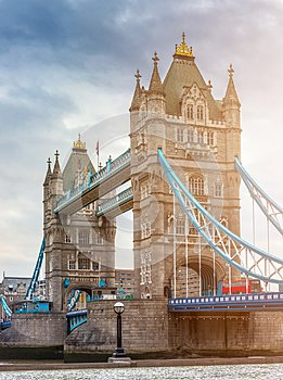 London, England - Tower Bridge, the icon of London on a cloudy morning with traditional red double-decker bus