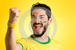 Brazilian supporter of National football team is celebrating, ch
