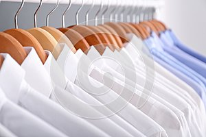 Clean clothes on hangers after dry-cleaning
