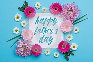 Happy Father`s day Pastel Candy Colours Background. Floral Father day flat lay.
