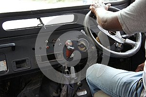 Close-up of a driver in an old off-road vehicle