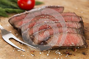 Cooked beef steak sliced medium rare close-up