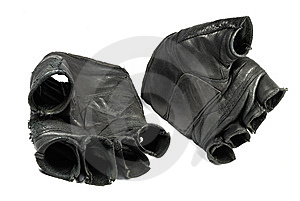Dirty sporting gloves isolated