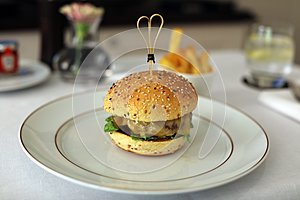 Premium hamburger with cheese lettuce and tomato exquisite meal, luxury meat unique cuisine in VIP gastronomy restaurant
