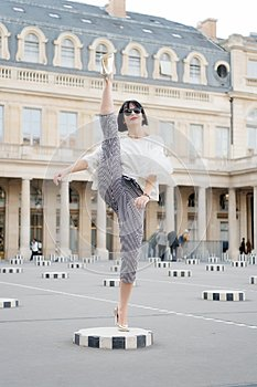Fashion and vogue. Sensual woman with brunette hair. Woman pose on high heel shoes in paris, france. Beauty girl with