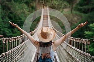Happy travel woman on vacation concept. Funny traveler enjoy her trip and ready to adventure.