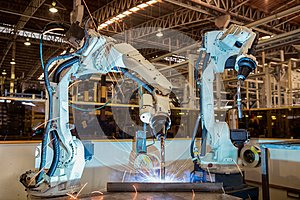 Industrial robot is welding assembly steel part in car factory