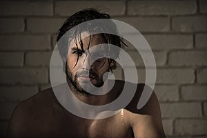 Personal care. man with wet hair, muscular body in bath, shower