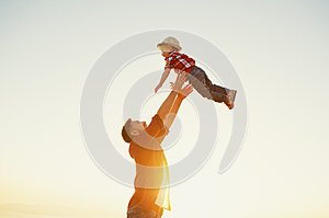 Father`s day. Happy family father and toddler son playing and la
