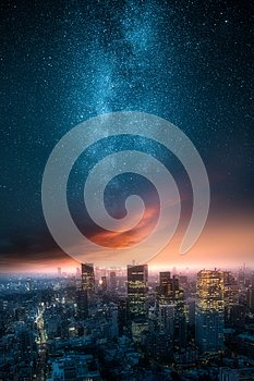 Dramatic view of a city skyline at night with milky way