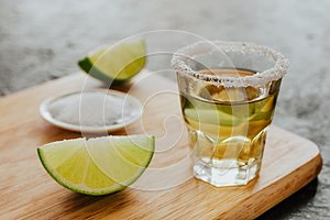 Tequila shot, mexican Alcoholic strong drinks and pieces of lime with salt in mexico