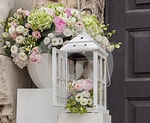 Wedding and marriage decoration. White boxes with flowers outside. Elegant bouquet. Arrangement and romance background.